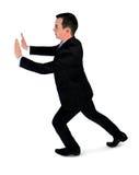 Spinta dell'uomo di affari qualcosa Fotografia Stock