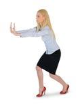 Spinta della donna di affari qualcosa Fotografia Stock