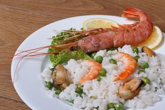 Spiny lobster, prawns, mussels with rice Royalty Free Stock Photography