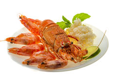 Spiny lobster, shrimps and rice Royalty Free Stock Photos