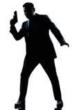 spion för silhouette för trycksprutaholdingman Arkivbild