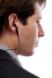 Spion med hörluren fotografering för bildbyråer