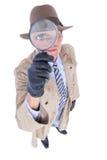 Spion som ser till och med förstoringsapparaten arkivfoto