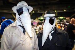 Spion vs den cosplay spionen Arkivbild