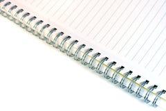 Spiraal gevoerd notitieboekje Stock Foto's