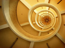 Spiral. Architectural abstract from looking up a spiral staircase Royalty Free Stock Photography
