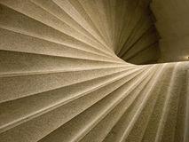 Spiral abstract. The underneath of a set of stone spiral steps creates an interesting abstract stock image