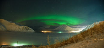 Spiral of Aurora polaris. Ribbons of Aurora polaris above mountains royalty free stock image