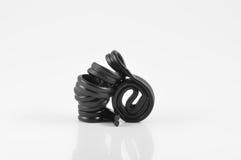Spiral av den svarta lakritsen Royaltyfri Foto