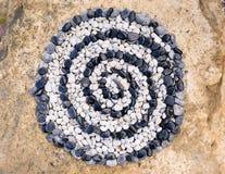 Spiral av kiselstenar Arkivbild