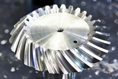 Spiral bevel gear. Metal sample royalty free stock photography