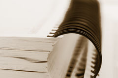 Spiral binder book. Close up shot of spiral binder book in sepia Royalty Free Stock Photography