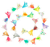Spiral birds. Paper folded birds arranged in a spiral shape and isolated on a white background Stock Photography