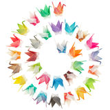 Spiral birds pattern. Paper folded birds arranged in a spiral shape and isolated on a white background Royalty Free Stock Photography