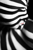 Spiral bodyart on the body of a young girl Royalty Free Stock Image