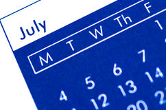 Spiral bound calendar displaying month of July. Stock Photos