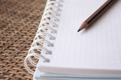 Spiral bound notebook with pencil Stock Image