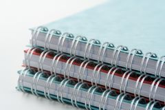 Spiral Bound Notebooks. Three spiral bound notebooks stock photography