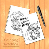 Spiral bound notepad or coloring book with pencils and Halloween picture Royalty Free Stock Photos
