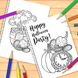 Spiral bound notepad or coloring book with pencils and Halloween picture Stock Photos