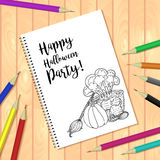 Spiral bound notepad or coloring book with pencils and Halloween picture Stock Images