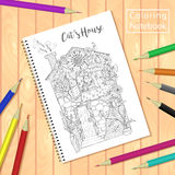 Spiral bound notepad or coloring book with pencils and picture, cats house. Royalty Free Stock Photo