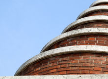 Spiral brick building. Spiral brick bizarre building in a cemetary Royalty Free Stock Photography