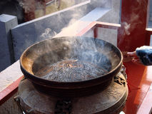Spiral burning joss sticks. In a Chinese temple Royalty Free Stock Images