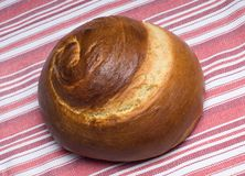 Spiral Challah Bread. Hebrew Spiral Challah Loaf of Bread  on Colorful Cloth Royalty Free Stock Photography