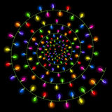 Spiral Christmas lights isolated on a black background Royalty Free Stock Photos