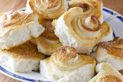 Spiral cinnamon French buns on the kitchen table. Royalty Free Stock Photography