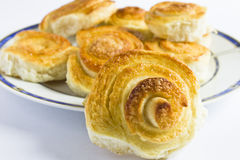 Spiral cinnamon French buns on white background. Stock Photo