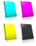 Spiral CMYK binder. Royalty Free Stock Image