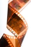 Spiral of color negative film strip Royalty Free Stock Images