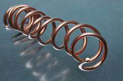 Spiral of copper wire on metal surface Stock Photo