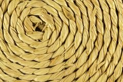 Spiral craftwork with bamboo fibers close up texture. Photo of Spiral craftwork with bamboo fibers close up texture Royalty Free Stock Images