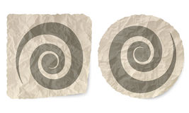 Spiral. Crumpled slip of paper and a spiral Royalty Free Stock Photo