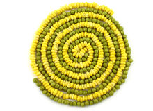 Spiral diet background. Vegetable spiral made from corn and green peas Stock Photos