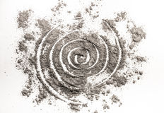 Spiral drawing in scattered ash as wormhole order in chaos Royalty Free Stock Photo
