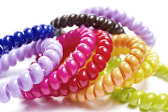 Spiral elastic rubber bands for hair. Of different colors Royalty Free Stock Images