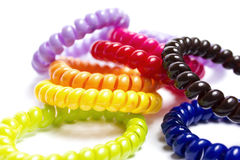 Spiral elastic rubber bands for hair. Of different colors Stock Photos