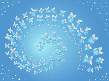 Spiral of flying butterflies on a blue Royalty Free Stock Photography