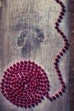 Spiral från röda pärlor Arkivbilder
