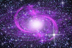 Spiral galaxy. Lilac spiral galaxy in far star space Stock Photo