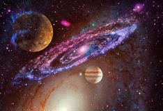 Spiral galaxy and planet in outer space stock photo