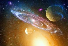 Spiral galaxy and planet in outer space royalty free stock image