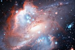 Spiral galaxy and stars in deep space. Elements of this image furnished by NASA.  stock photography