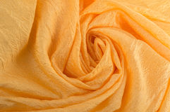 Spiral gold fabric. Golden cloth laid spiral close-up Royalty Free Stock Photos