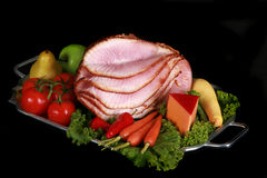 Spiral ham on a black background Royalty Free Stock Photography