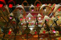 Spiral incense coils of Man mo temple hong kong. Pattern of spiral incense coils hanging from the ceiling at man mo temple in hong kong Stock Photo